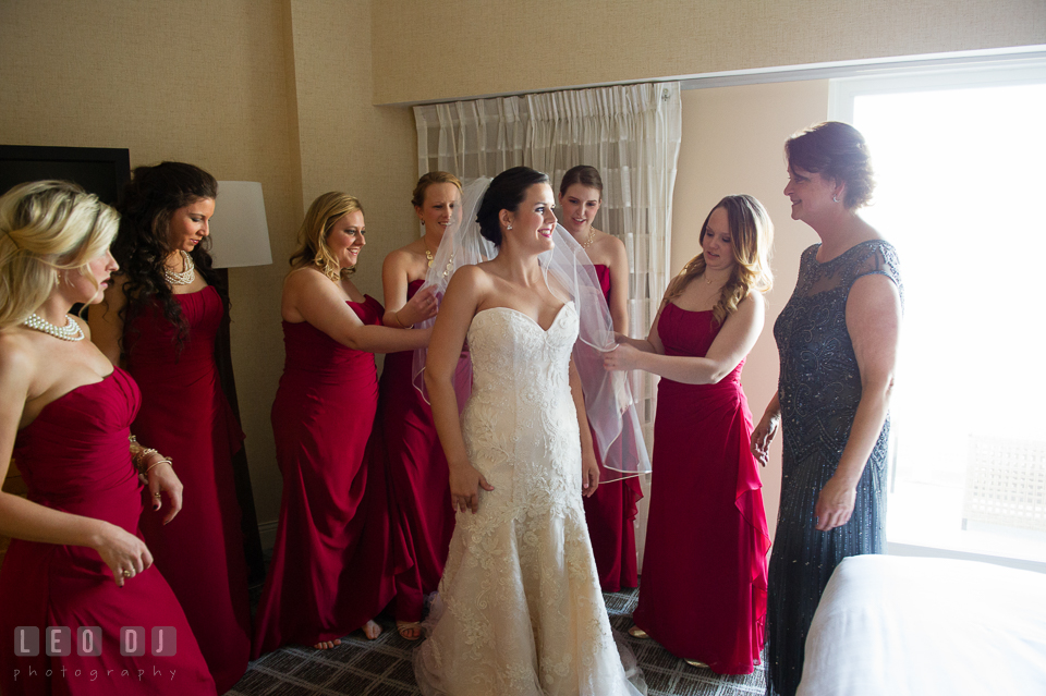 Bridesmaids, Maid of Honor, and Mother helping Bride put on wedding dress. Hyatt Regency Chesapeake Bay wedding at Cambridge Maryland, by wedding photographers of Leo Dj Photography. http://leodjphoto.com