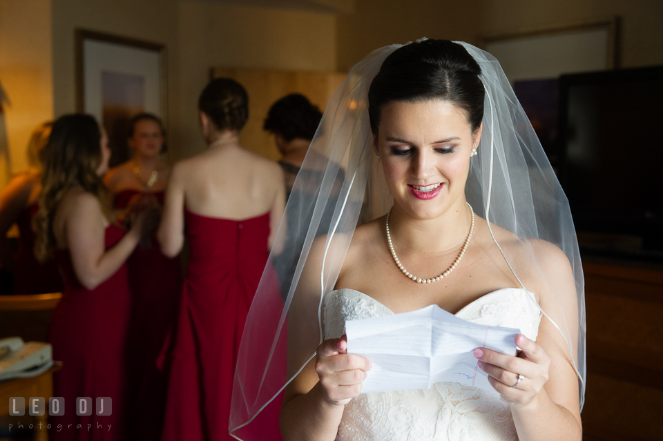 Bride reading letter from Groom. Hyatt Regency Chesapeake Bay wedding at Cambridge Maryland, by wedding photographers of Leo Dj Photography. http://leodjphoto.com