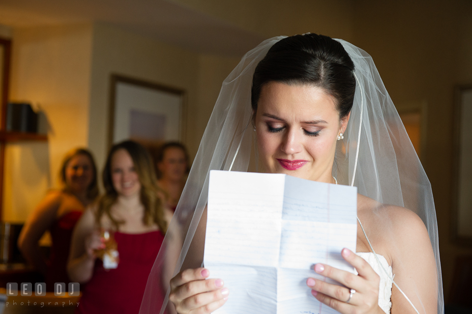 Bride is getting emotional reading letter from Groom. Hyatt Regency Chesapeake Bay wedding at Cambridge Maryland, by wedding photographers of Leo Dj Photography. http://leodjphoto.com