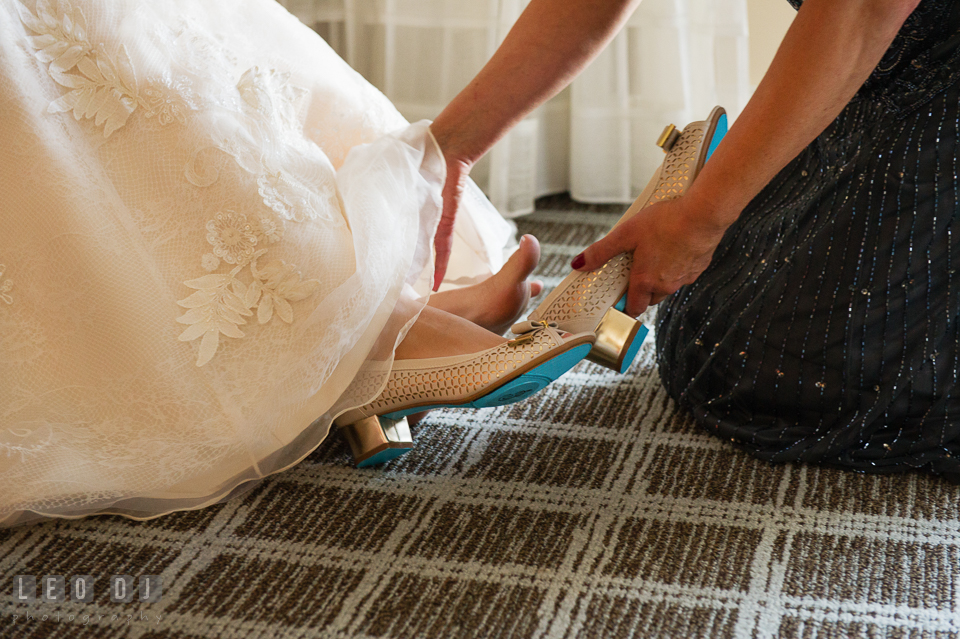 Mother of the Bride helps daughter put on wedding shoes. Hyatt Regency Chesapeake Bay wedding at Cambridge Maryland, by wedding photographers of Leo Dj Photography. http://leodjphoto.com