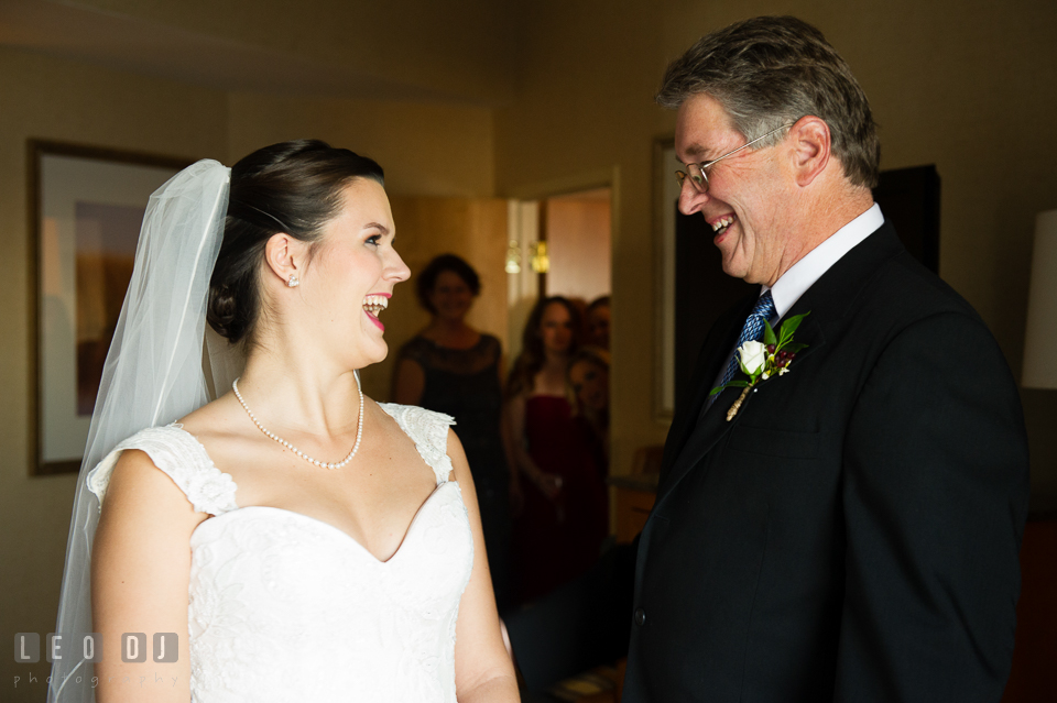 Bride smiling with Father of the Bride upon first reveal. Hyatt Regency Chesapeake Bay wedding at Cambridge Maryland, by wedding photographers of Leo Dj Photography. http://leodjphoto.com