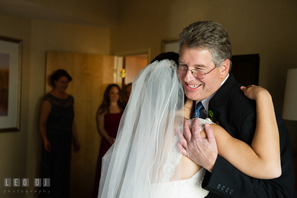Bride hugging Father of the Bride during first look with Dad. Hyatt Regency Chesapeake Bay wedding at Cambridge Maryland, by wedding photographers of Leo Dj Photography. http://leodjphoto.com