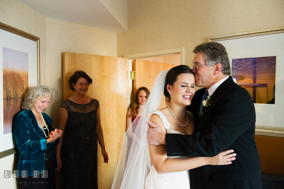 Father of the Bride kissed daughter in front of family. Hyatt Regency Chesapeake Bay wedding at Cambridge Maryland, by wedding photographers of Leo Dj Photography. http://leodjphoto.com