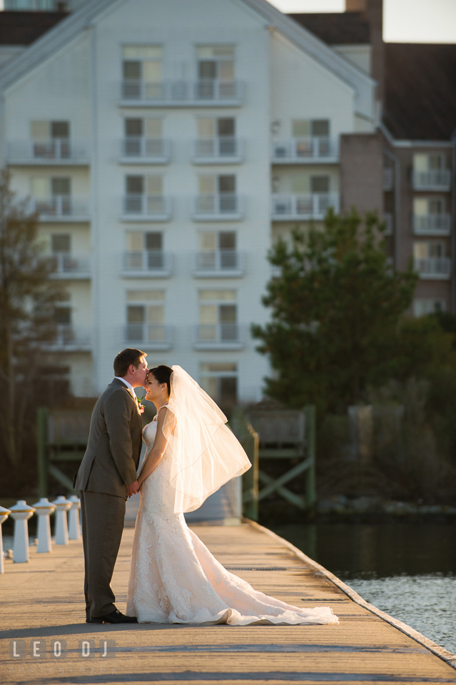 Groom kisses Bride's forehead at the boat dock. Hyatt Regency Chesapeake Bay wedding at Cambridge Maryland, by wedding photographers of Leo Dj Photography. http://leodjphoto.com