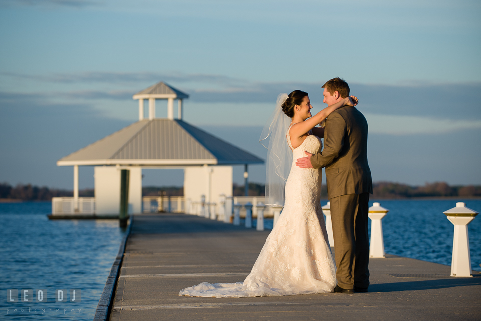 Bride and Groom on romantic photo session by the water. Hyatt Regency Chesapeake Bay wedding at Cambridge Maryland, by wedding photographers of Leo Dj Photography. http://leodjphoto.com