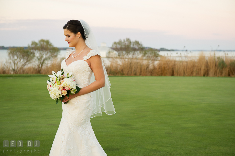 Bride with wedding flower bouquet. Hyatt Regency Chesapeake Bay wedding at Cambridge Maryland, by wedding photographers of Leo Dj Photography. http://leodjphoto.com