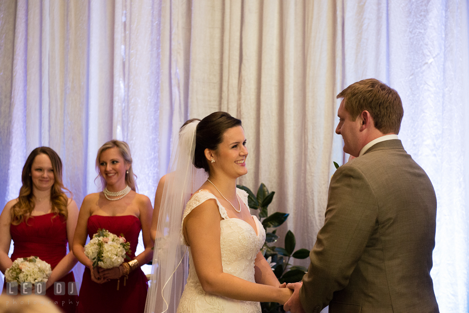 Bride and Groom smiling reciting their wedding vows during ceremony. Hyatt Regency Chesapeake Bay wedding at Cambridge Maryland, by wedding photographers of Leo Dj Photography. http://leodjphoto.com