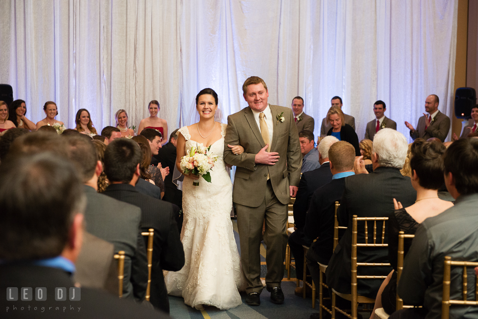 Bride and Groom walking out of the aisle during wedding ceremony recessional. Hyatt Regency Chesapeake Bay wedding at Cambridge Maryland, by wedding photographers of Leo Dj Photography. http://leodjphoto.com