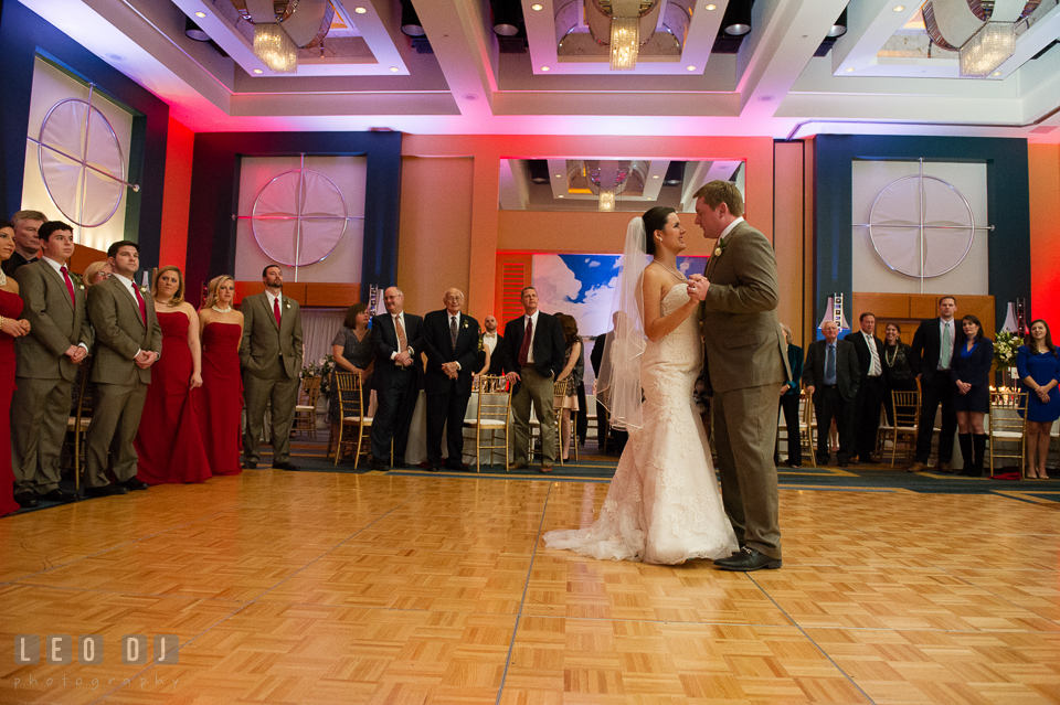 Bride and Groom's first dance seen by the wedding party and family. Hyatt Regency Chesapeake Bay wedding at Cambridge Maryland, by wedding photographers of Leo Dj Photography. http://leodjphoto.com