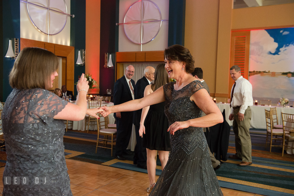 Mother of the Bride dancing with guest during wedding reception. Hyatt Regency Chesapeake Bay wedding at Cambridge Maryland, by wedding photographers of Leo Dj Photography. http://leodjphoto.com