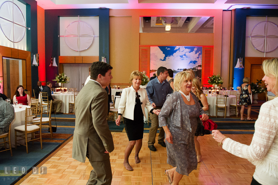 Guests dancing with Mother of Groom during wedding reception. Hyatt Regency Chesapeake Bay wedding at Cambridge Maryland, by wedding photographers of Leo Dj Photography. http://leodjphoto.com