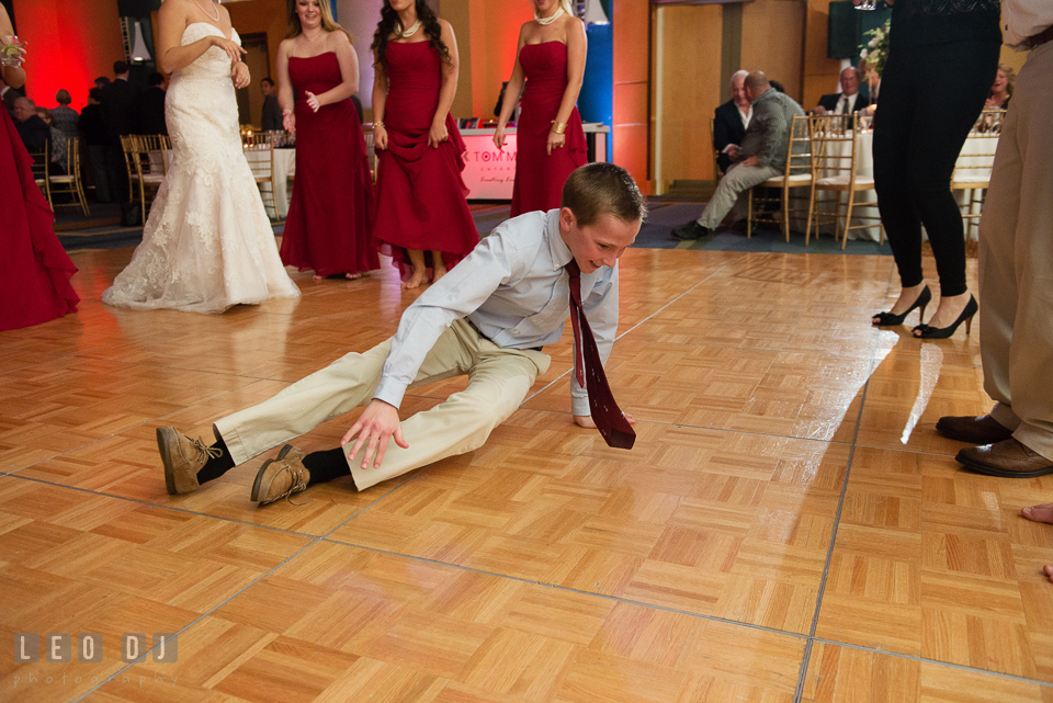 A young guest showing of his dance move on the floor during wedding reception. Hyatt Regency Chesapeake Bay wedding at Cambridge Maryland, by wedding photographers of Leo Dj Photography. http://leodjphoto.com