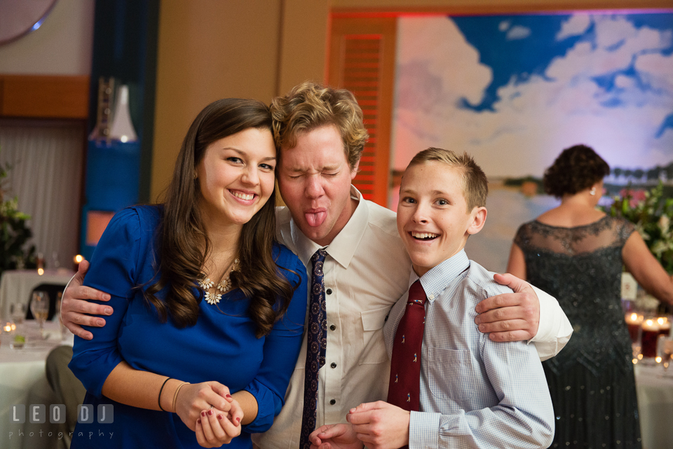 Guests making goofy faces during wedding reception. Hyatt Regency Chesapeake Bay wedding at Cambridge Maryland, by wedding photographers of Leo Dj Photography. http://leodjphoto.com