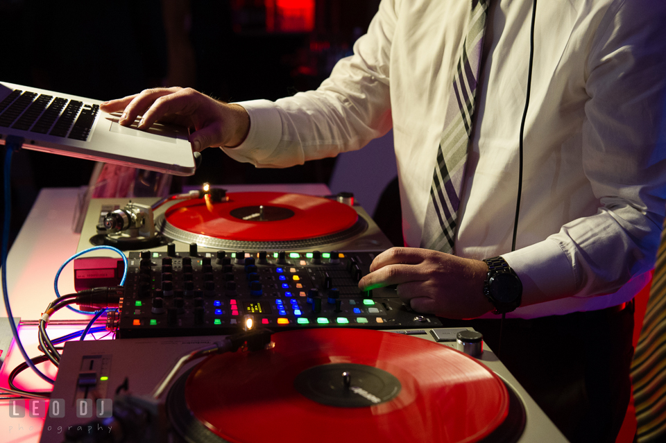DJ Tommy Gatz mixing music for guests in wedding reception. Hyatt Regency Chesapeake Bay wedding at Cambridge Maryland, by wedding photographers of Leo Dj Photography. http://leodjphoto.com