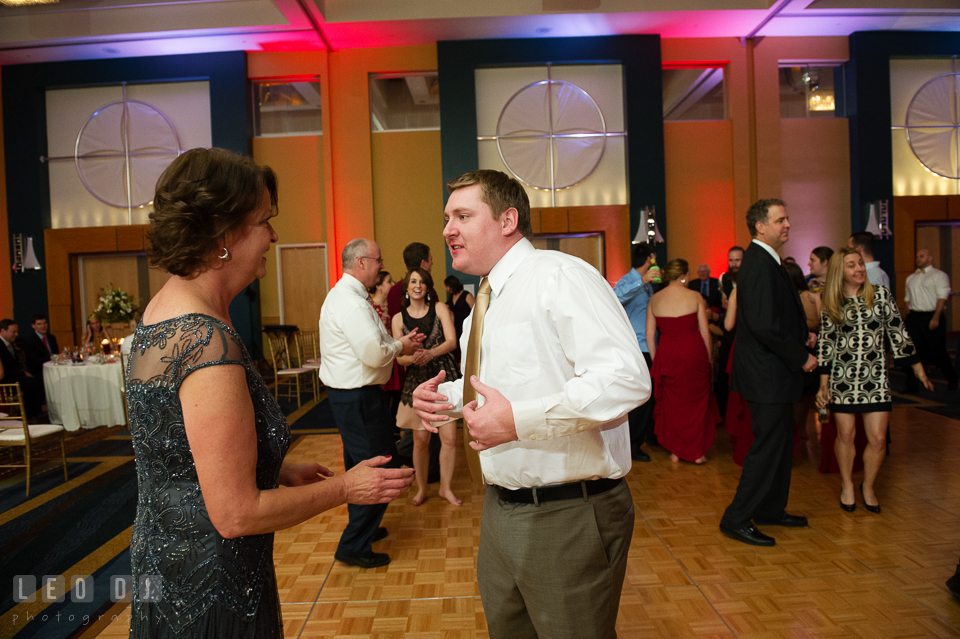 Mother of the Bride dances with Groom during wedding reception. Hyatt Regency Chesapeake Bay wedding at Cambridge Maryland, by wedding photographers of Leo Dj Photography. http://leodjphoto.com