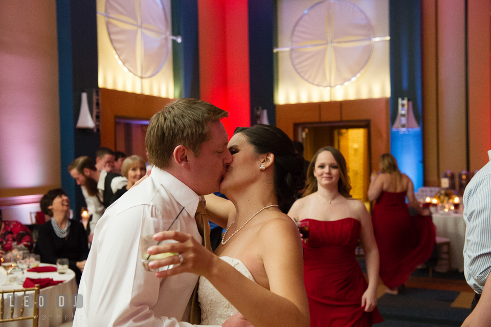 Bride and Groom kissing during wedding reception. Hyatt Regency Chesapeake Bay wedding at Cambridge Maryland, by wedding photographers of Leo Dj Photography. http://leodjphoto.com