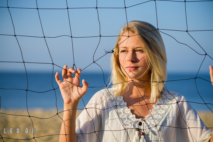 Girl holding volley ball net. Kent Island and Annapolis, Eastern Shore, Maryland model portrait photo session at Sandy Point Beach by photographer Leo Dj Photography. http://leodjphoto.com