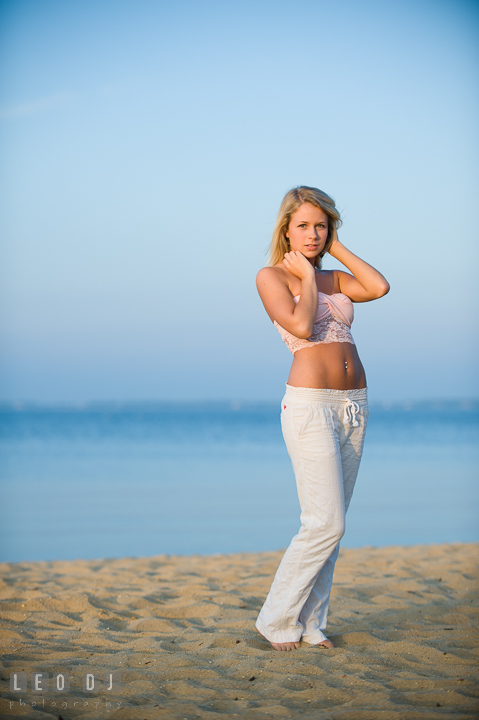 Gorgeous girl with short top and long pants posing on the sand. Kent Island and Annapolis, Eastern Shore, Maryland model portrait photo session at Sandy Point Beach by photographer Leo Dj Photography. http://leodjphoto.com