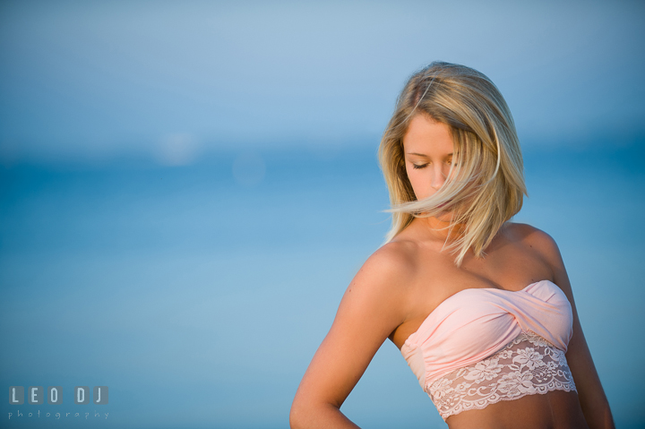 Beautiful girl with blonde hair blown by wind. Kent Island and Annapolis, Eastern Shore, Maryland model portrait photo session at Sandy Point Beach by photographer Leo Dj Photography. http://leodjphoto.com