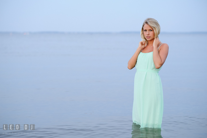 Gorgeous girl with blonde hair and long dress in the water. Kent Island and Annapolis, Eastern Shore, Maryland model portrait photo session at Sandy Point Beach by photographer Leo Dj Photography. http://leodjphoto.com