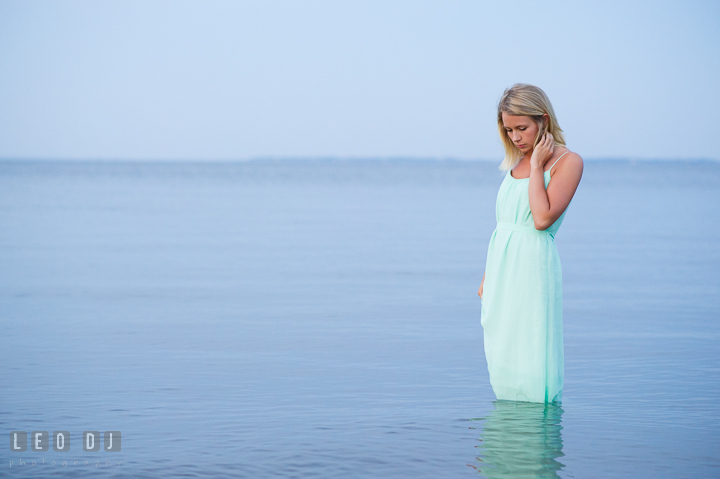 Beautiful girl in the water looking down. Kent Island and Annapolis, Eastern Shore, Maryland model portrait photo session at Sandy Point Beach by photographer Leo Dj Photography. http://leodjphoto.com