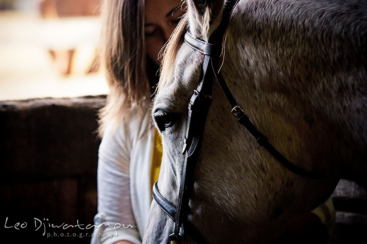 Horse and owner in a barn. Annapolis Kent Island Maryland High School Senior Portrait Photography with Horse Pet by photographer Leo Dj
