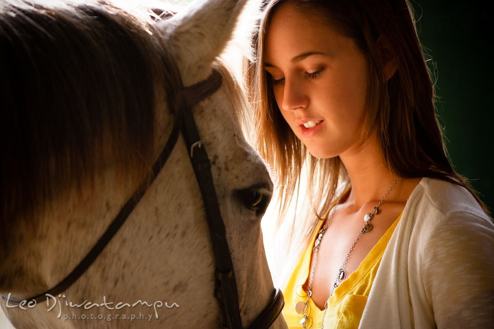 Girl looking at her horse. Annapolis Kent Island Maryland High School Senior Portrait Photography with Horse Pet by photographer Leo Dj