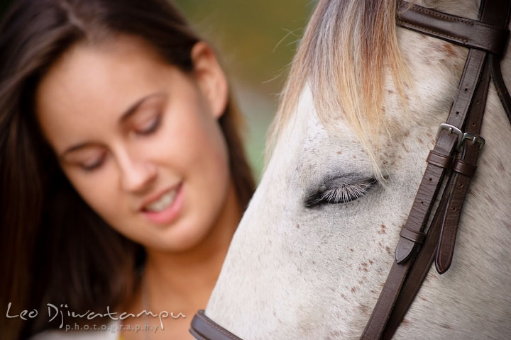 Horse closed eyes, enjoying being pet by owner. Annapolis Kent Island Maryland High School Senior Portrait Photography with Horse Pet by photographer Leo Dj