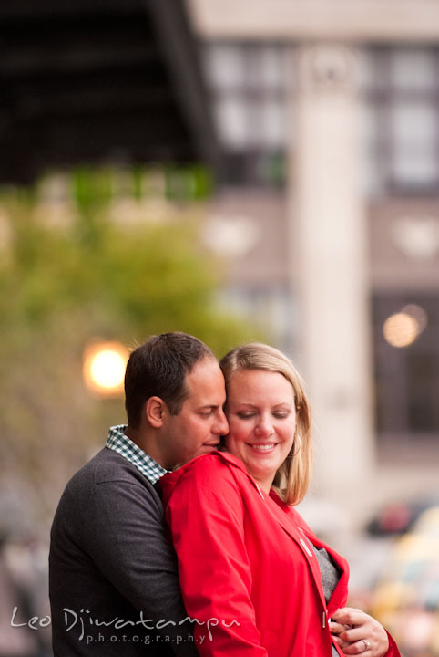 Engaged guy hugging his fiancée. Pennsylvania Train Station Baltimore Maryland pre-wedding engagement photo session by wedding photographer Leo Dj Photography.