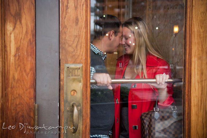 Engaged girl touching noses with her fiancé. Pennsylvania Train Station Baltimore Maryland pre-wedding engagement photo session by wedding photographer Leo Dj Photography.