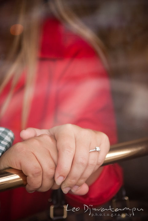 Engaged couple holding hands showing engagement ring. Pennsylvania Train Station Baltimore Maryland pre-wedding engagement photo session by wedding photographer Leo Dj Photography.