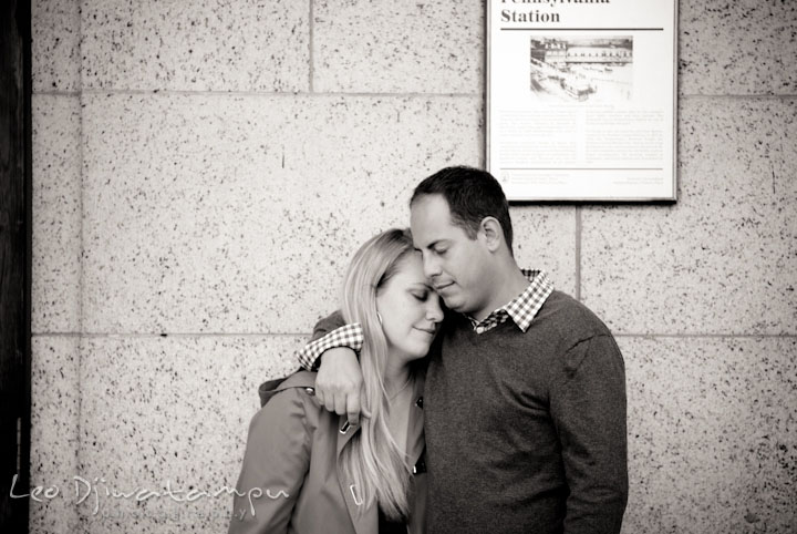 Engaged girl leaning her head on her fiancé. Pennsylvania Train Station Baltimore Maryland pre-wedding engagement photo session by wedding photographer Leo Dj Photography.