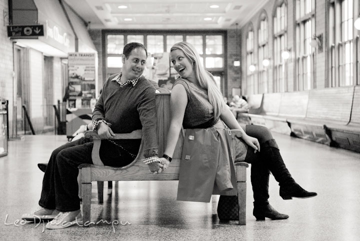 Engaged guy holding his fiancée on a bench. Pennsylvania Train Station Baltimore Maryland pre-wedding engagement photo session by wedding photographer Leo Dj Photography.