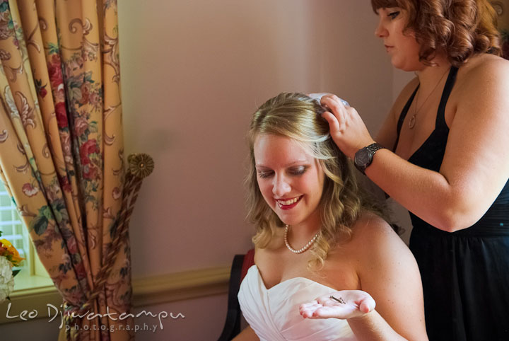 Best friend helping bride putting on veil. Mariott Aspen Wye River Conference Center Wedding photos at Queenstown Eastern Shore Maryland, by photographers of Leo Dj Photography.