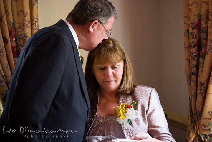Father of Bride kissed Mom while she opens a gift. Mariott Aspen Wye River Conference Center Wedding photos at Queenstown Eastern Shore Maryland, by photographers of Leo Dj Photography.