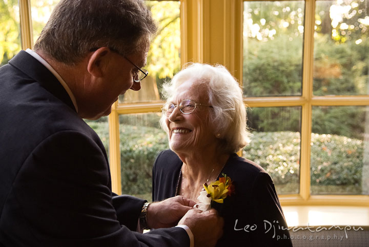 Father of Bride put on boutonniere on grandma. Mariott Aspen Wye River Conference Center Wedding photos at Queenstown Eastern Shore Maryland, by photographers of Leo Dj Photography.