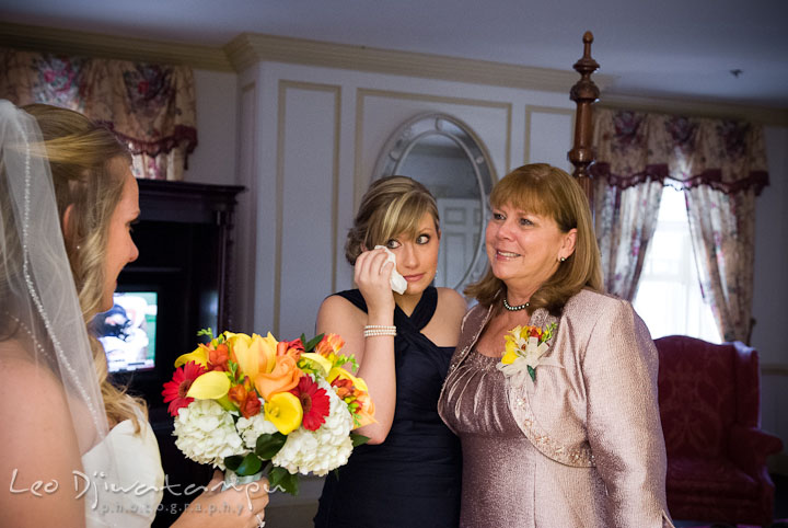 Mother of Bride and sister shed tear, proud of their daughter or sister. Mariott Aspen Wye River Conference Center Wedding photos at Queenstown Eastern Shore Maryland, by photographers of Leo Dj Photography.