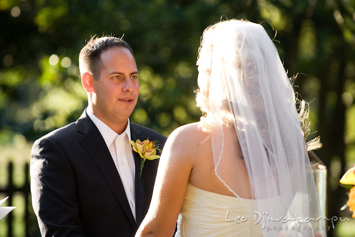 Groom reciting vow to Bride. Mariott Aspen Wye River Conference Center Wedding photos at Queenstown Eastern Shore Maryland, by photographers of Leo Dj Photography.
