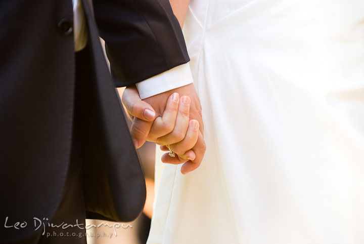 Close up of Bride and Groom holding hands during ceremony. Mariott Aspen Wye River Conference Center Wedding photos at Queenstown Eastern Shore Maryland, by photographers of Leo Dj Photography.