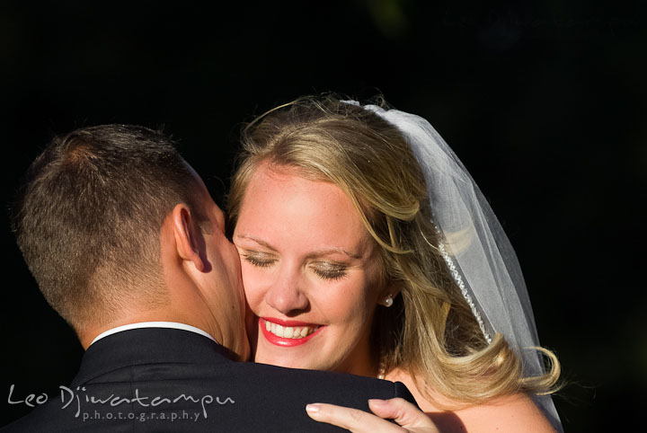 Bride and Groom hugging during the ceremony. Mariott Aspen Wye River Conference Center Wedding photos at Queenstown Eastern Shore Maryland, by photographers of Leo Dj Photography.