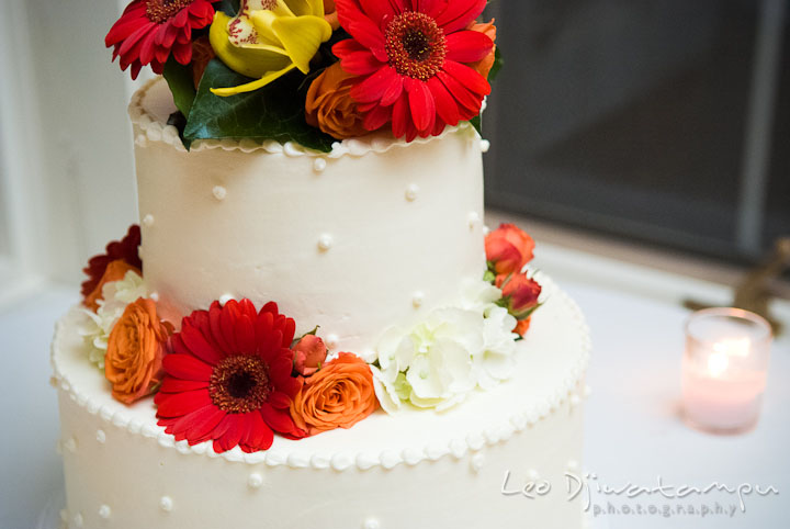 Wedding cake with flower decorations. Mariott Aspen Wye River Conference Center Wedding photos at Queenstown Eastern Shore Maryland, by photographers of Leo Dj Photography.