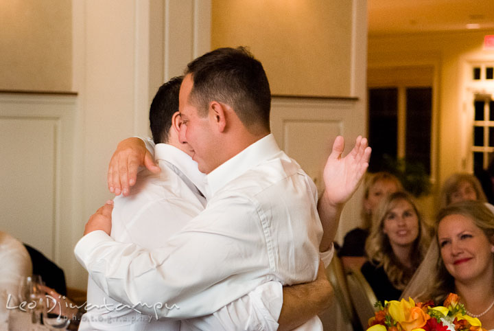 Best Man and Groom hugged after speech. Mariott Aspen Wye River Conference Center Wedding photos at Queenstown Eastern Shore Maryland, by photographers of Leo Dj Photography.