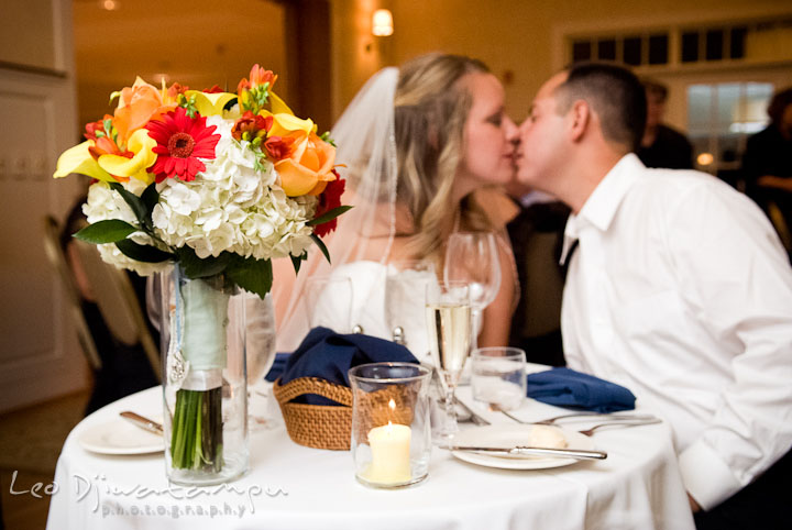 Bride and Groom kissing at the sweetheart table. Mariott Aspen Wye River Conference Center Wedding photos at Queenstown Eastern Shore Maryland, by photographers of Leo Dj Photography.