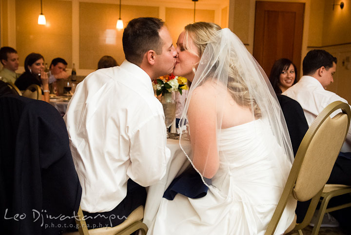 Bride and Groom kissing after glass clinks. Mariott Aspen Wye River Conference Center Wedding photos at Queenstown Eastern Shore Maryland, by photographers of Leo Dj Photography.