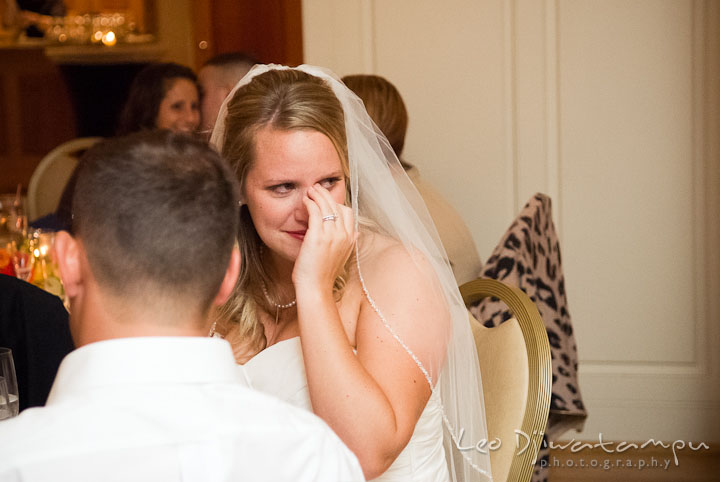 Bride wiping tears from eyes. Mariott Aspen Wye River Conference Center Wedding photos at Queenstown Eastern Shore Maryland, by photographers of Leo Dj Photography.