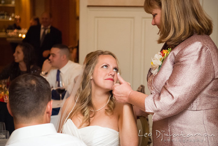 Mother of Bride wiping off tears from daugther's eyes. Mariott Aspen Wye River Conference Center Wedding photos at Queenstown Eastern Shore Maryland, by photographers of Leo Dj Photography.