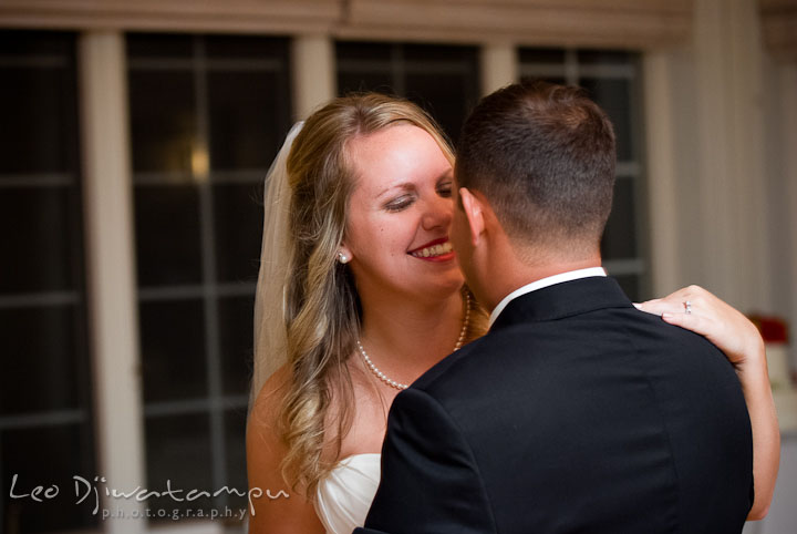 Bride and Groom smiling during first dance. Mariott Aspen Wye River Conference Center Wedding photos at Queenstown Eastern Shore Maryland, by photographers of Leo Dj Photography.