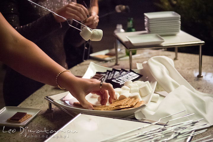 Guests making s'mores. Mariott Aspen Wye River Conference Center Wedding photos at Queenstown Eastern Shore Maryland, by photographers of Leo Dj Photography.