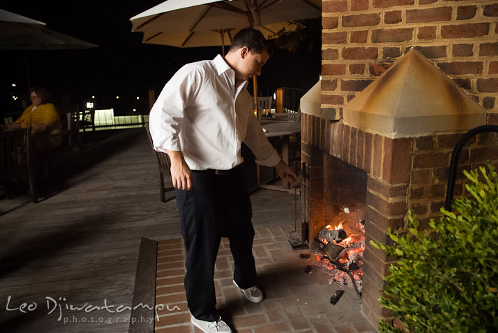 Best Man roasting the marshmallow. Mariott Aspen Wye River Conference Center Wedding photos at Queenstown Eastern Shore Maryland, by photographers of Leo Dj Photography.