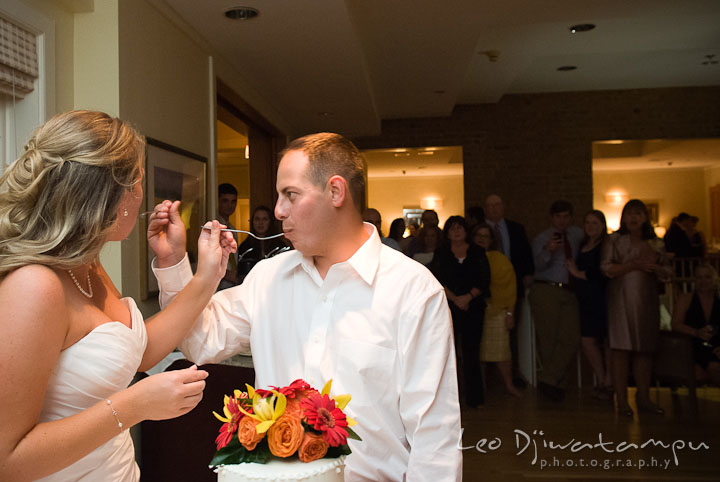 Bride and groom feeding cake to each other. Mariott Aspen Wye River Conference Center Wedding photos at Queenstown Eastern Shore Maryland, by photographers of Leo Dj Photography.